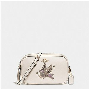 Coach chalk color crossbody bag with bird detail